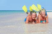 Senior Couple With Snorkels Enjoying Beach Holiday — Stock Photo