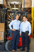 Portrait Of Businessmen With Fork Lift Truck In Warehouse — Stock Photo