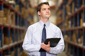 Manager In Warehouse With Clipboard — Stock Photo