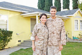 Military Couple In Uniform Standing Outside House — Stock Photo