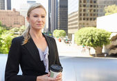 Businesswoman Drinking Takeaway Coffee Outside Office — Foto Stock
