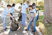 Team Of Volunteers Picking Up Litter In Suburban Street — Stock Photo