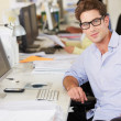 Stock Photo: MWorking At Desk In Busy Creative Office