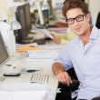 Man Working At Desk In Busy Creative Office — Stock Photo #25050031