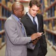 Two Businessmen Having Discussion In Warehouse — Stock Photo