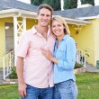 Couple Standing Outside SuburbHome — Stock Photo #25050055