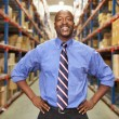 Stock Photo: Portrait Of BusinessmIn Warehouse