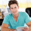 Man Using Digital Tablet In Busy Creative Office — Stock Photo