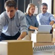 Stock Photo: Workers In Distribution Warehouse