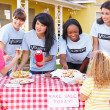 Women And Children Running Charity Bake Sale - Stock Photo