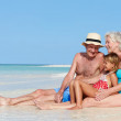 Grandparents With Granddaughter Enjoying Beach Holiday — Stock Photo