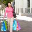 Woman Carrying Shopping Bags On City Street — Stock Photo