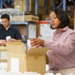 Manager Checking Goods On Production Line — Stock Photo #25050185