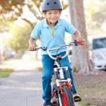 Boy Wearing Safety Helmet Riding Bike — Stock Photo #25050187