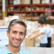 Man At Computer Terminal In Distribution Warehouse — Stock Photo #25050209
