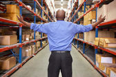 Rear View Of Businessman In Warehouse — Stock Photo