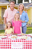 Family Running Charity Bake Sale — Stock Photo