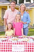 Family Running Charity Bake Sale — Stock Photo