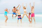Multi Generation Family Having Fun In Sea On Beach Holiday — Stock Photo