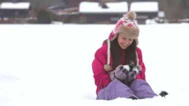 Teenage girl and boy playing in the snow — Stock Video