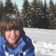 Stock Video: Boy throws handfuls of snow above his head.