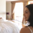 Woman jumping onto bed to wake man — Stock Video