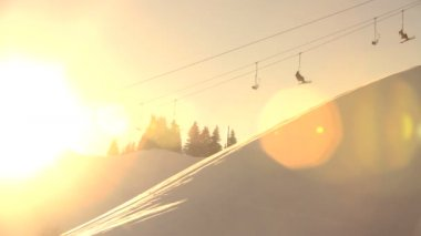 Skiers ride chairlift across frame — Stock Video