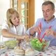 Senior couple seated around dining table — Stock Video