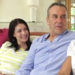 Happy couples relaxing on sofa chatting together. — Stock Video
