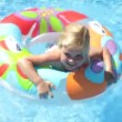 Girl in inflatable rubber ring paddles — Stock Video