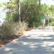 Romantic senior couple cycling along country path  — Stok video