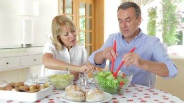 Senior couple seated around dining table — Stock Video