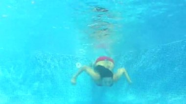 Underwater view as woman swims — Stock Video