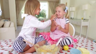 Two girls tasting cake mixture — Stock Video