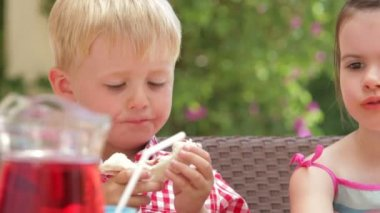Boy and girl eating food at birthday party — Stock Video
