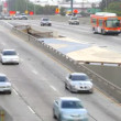 Time lapse view of speeding traffic taken from bridge over freeway. - Stock Photo