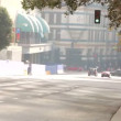 Speeding traffic passing though intersection on city road. — Stock Video