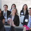 Stock Video: Businesspeople listening to presentation.