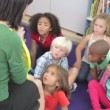 Teacher explaining to children how to tell the time  — Stok video