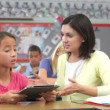 Teacher and student  discuss information on tablet computer. — Vídeo Stock