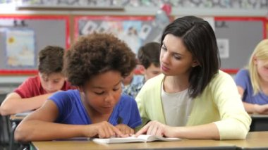 Teacher and student read together. — Video Stock