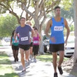 Stock Video: Group Of Runners On Suburban Street