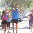 Group Of Women Running Along Street With Personal Trainer — Vídeo Stock