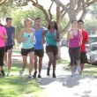Group Of Runners On Suburban Street — Stock Video