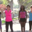 Stock Video: Group Of Exercising Street With Personal Trainer