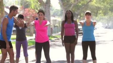 Group Of Exercising Street With Personal Trainer — Stock Video