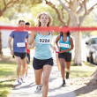 Stock Photo: Female Runner Winning Marathon