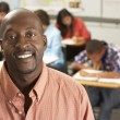 Stock Photo: Portrait Of Teacher In Classroom