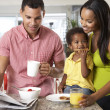 Family Having Breakfast In Kitchen Together — Stock Photo #27553019