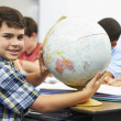 Pupils Studying Geography In Classroom — Stock Photo #27553071